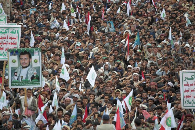 Houthi supporters attend a rally to mark the seventh anniversary of the Houthis' takeover of the Yemeni capital, in Sanaa, Yemen, Tuesday, September 21, 2021. (Photo by Hani Mohammed/AP Photo)