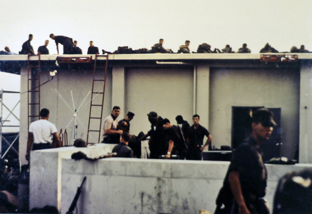 This April 30, 1975 photo provided by former U.S. Marines Master Gunnery Sgt. Juan Valdez shows Marines barricading themselves on the roof of the U.S. Embassy in Saigon, Vietnam. On the 40th anniversary of the fall of Saigon, 13 Marines returned to dedicate a plaque to their two fallen brothers at the site of the old embassy, which is now the U.S. Consulate. (Photo by Juan Valdez/AP Photo)