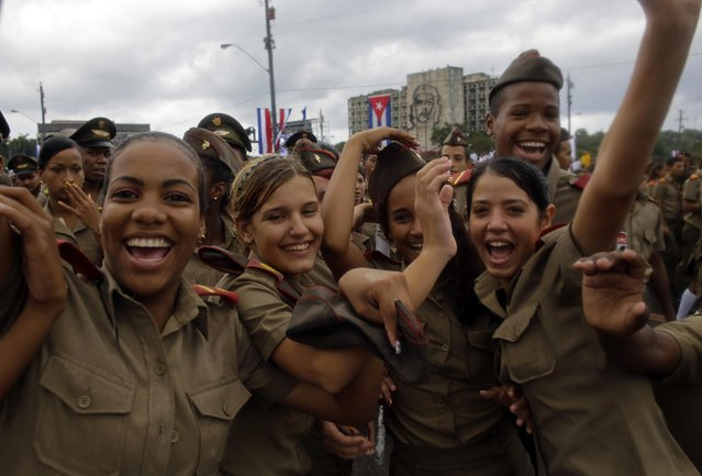 Cuban army cadets react to the photographer as they march in Revolution Square marking May Day, in Havana, Cuba, Friday, May 1, 2015. (Photo by Ramon Espinosa/AP Photo)