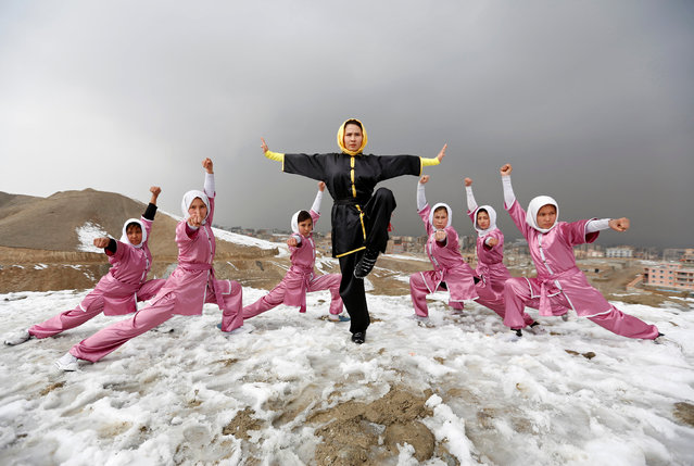 Sima Azimi (C), 20, a trainer at the Shaolin Wushu club, poses with her students after an exercise on a hilltop in Kabul, Afghanistan January 29, 2017. (Photo by Mohammad Ismail/Reuters)