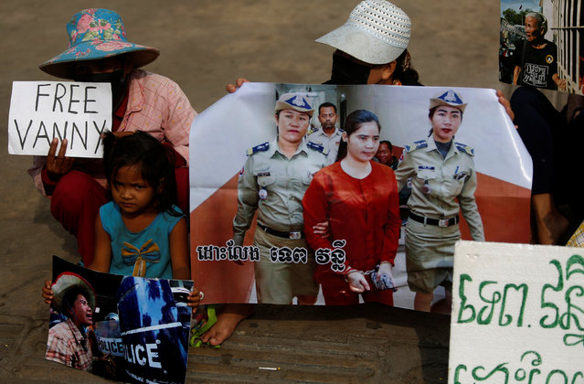 Protesters hold an image of land-rights activist Tep Vanny as they demonstrate in support her, in front of the Phnom penh Municipal Court during her verdict in central Phnom Penh, Cambodia, February 23, 2017. (Photo by Samrang Pring/Reuters)