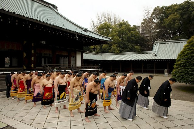 "Sumo wrestlers pray before the start of the ""Honozumo"" ceremonial sumo tournament at the Yasukuni Shrine in Tokyo April 3, 2015. (Photo by Thomas Peter/Reuters)"