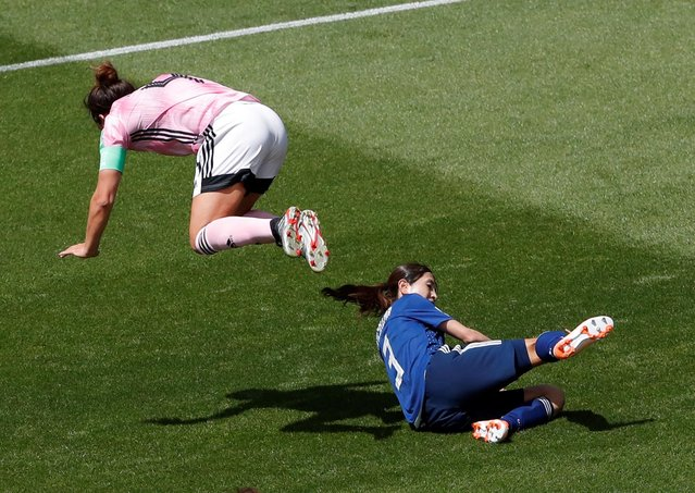 Rachel Corsie of Scotland is challenged by Aya Sameshima of Japan during the 2019 FIFA Women's World Cup France group D match between Japan and Scotland at Roazhon Park on June 14, 2019 in Rennes, France. (Photo by Stephane Mahe/Reuters)
