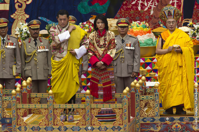 His majesty King Jigme Khesar Namgyel Wangchuck (L), 31, fixes his royal sash during the purification marriage ceremony to Queen Jetsun Pema