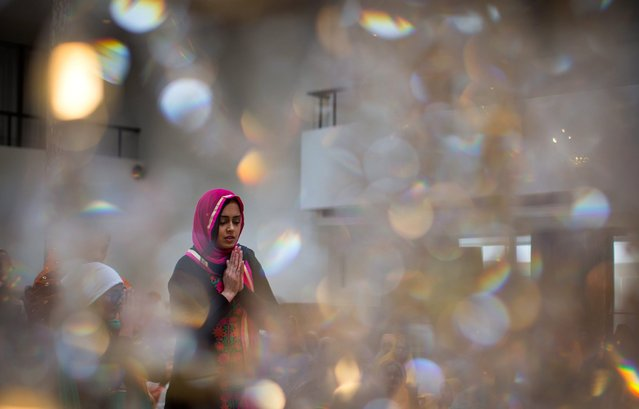 A woman prays at the Khalsa Diwan Society Sikh Temple before the annual Vaisakhi parade in Vancouver on Saturday, April 16, 2016. Vaisakhi is a significant holiday on the Sikh calendar, commemorating the establishment of the Khalsa in 1699 and marking the beginning of the Punjabi harvest year. (Photo by Darryl Dyck/The Canadian Press via AP Photo)