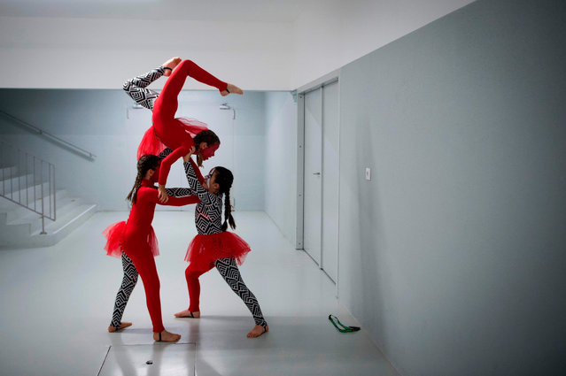 Dancers rehearse backstage during the Dance World Cup in Braga on July 4, 2019. The competition gathers more than 6000 dancers and brings together classical ballet, contemporary hip-hop, street dance, jazz, national folklore and ballroom dances into a single event. (Photo by Miguel Riopa/AFP Photo)