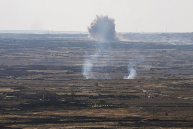 Smoke rises during fighting in Syria, as seen from the Israeli side of the border fence between Syria and the Israeli-occupied Golan Heights, June 17, 2015. Israel signaled readiness on Tuesday to intervene if Syrian refugees were to throng to its armistice line on the Golan Heights, after Israel's Druze Arab minority stepped up a public campaign to help brethren caught up in the civil war next door. REUTERS/Baz Ratner
