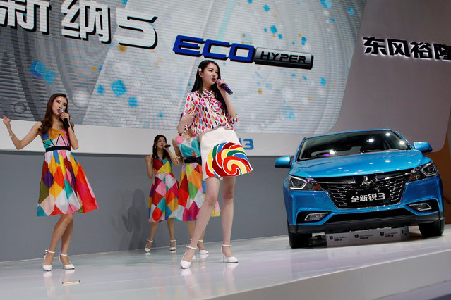Girls perform next to Luxgen S3 sedan presented at company's booth during the Auto China 2016 auto show in Beijing April 26, 2016. (Photo by Kim Kyung-Hoon/Reuters)