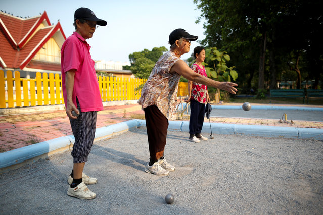 Elderly people play petanque at Bangkhae Home Foundation in Bangkok, Thailand, April 27, 2016. (Photo by Athit Perawongmetha/Reuters)