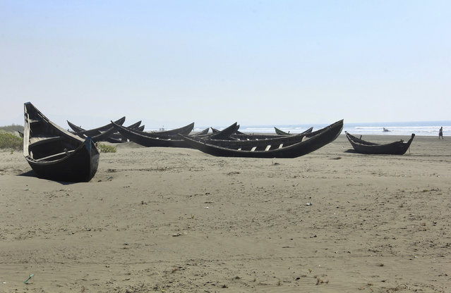 In this January 16, 2017, photo, traditional wooden boats of the Rohingya fishermen sit along the beach abandoned in Maungdaw, western Rakhine state, Myanmar. (Photo by Esther Htusan/AP Photo)
