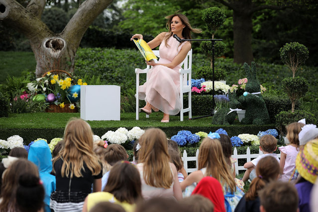 U.S. first lady Melania Trump reads 'Party Animals' by Kathy Lee Gifford during the 139th Easter Egg Roll on the South Lawn of the White House April 17, 2017 in Washington, DC. The White House said 21,000 people are expected to attend the annual tradition of rolling colored eggs down the White House lawn that was started by President Rutherford B. Hayes in 1878. (Photo by Chip Somodevilla/Getty Images)