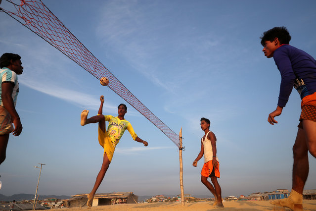 Rohingya refugees play Chinlone at a refugee camp in Cox's Bazar, Bangladesh on April 7, 2019. (Photo by Mohammad Ponir Hossain/Reuters)