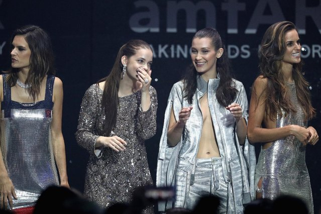 (L-R) Allesandra Ambrosio, Barbara Palvin, Bella Hadid and  Izabel Goulart appear on stage at the amfAR's 23rd Cinema Against AIDS Gala at Hotel du Cap-Eden-Roc on May 19, 2016 in Cap d'Antibes, France. (Photo by Andreas Rentz/Getty Images)