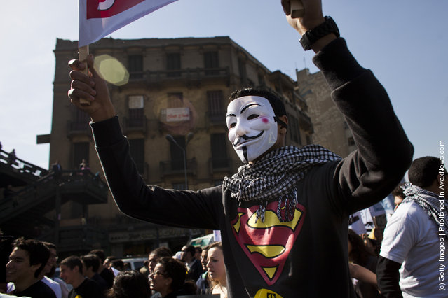 A protester wears a Guy Fawkes mask during a demonstration of students on February 11, 2012 in Cairo, Egypt