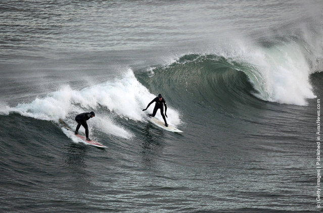 Surfers Brave The Cold To Enjoy Year Round Surfing