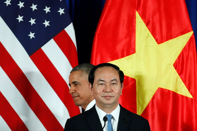 U.S. President Barack Obama attends a press conference with Vietnam's President Tran Dai Quang at the Presidential Palace Compound in Hanoi, Vietnam May 23, 2016. (Photo by Carlos Barria/Reuters)