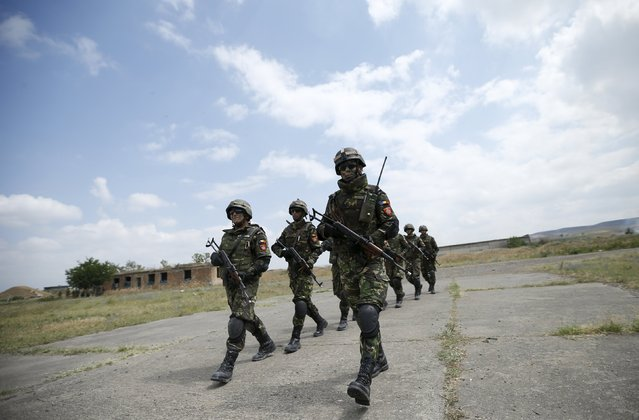 "Romanian soldiers march during a joint military exercise with NATO members, called ""Agile Spirit 2015"" at the Vaziani military base outside Tbilisi, Georgia, July 21, 2015. (Photo by David Mdzinarishvili/Reuters)"