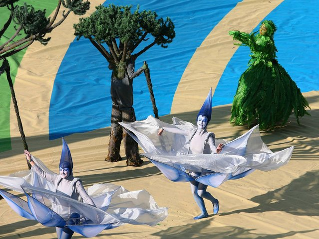 Artists perform during the Opening Ceremony of the 2014 FIFA World Cup Brazil prior to the Group A match between Brazil and Croatia at Arena de Sao Paulo on June 12, 2014 in Sao Paulo, Brazil. (Photo by Elsa/Getty Images)