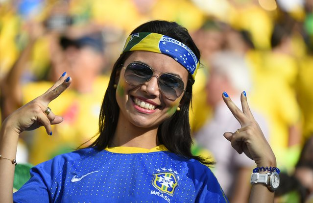 A Brazilian fan poses prior to the Group A football match between Brazil and Croatia at the Corinthians Arena in Sao Paulo during the 2014 FIFA World Cup on June 12, 2014. (Photo by Fabrice Coffrini/AFP Photo)
