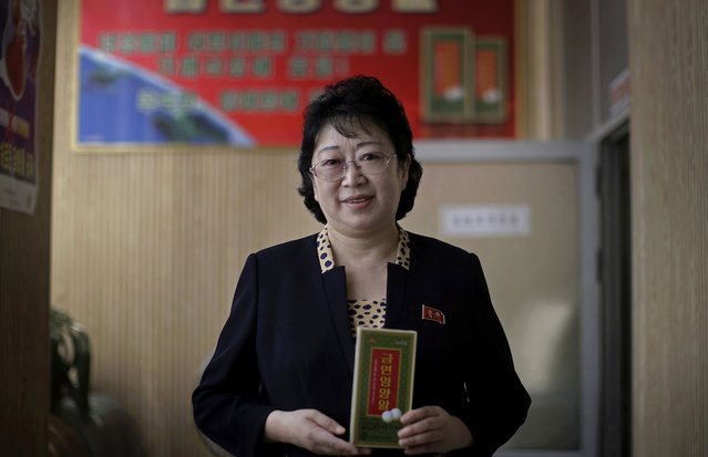 """In this June 25, 2016, photo, Ri Yong Ok, a 57-year-old pharmacist whose heavy-smoking husband nearly died of lung cancer, poses for a portrait with a box of anti-smoking medicine she developed at a small anti-smoking center she manages in Pyongyang, North Korea. Her motto: """"I hope every man quits smoking for his health and family, and I will help"""". (Photo by Wong Maye-E/AP Photo)"""