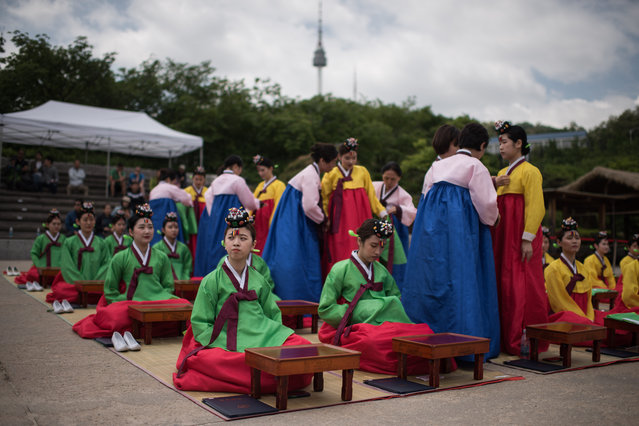 South Korean students attend a traditional coming-of-age ceremony at Namsan hanok village in Seoul on May 15, 2017. The ceremony marks the age of 19, at which a person is legally able to make life choices from voting, to drinking alcohol. (Photo by Ed Jones/AFP Photo)