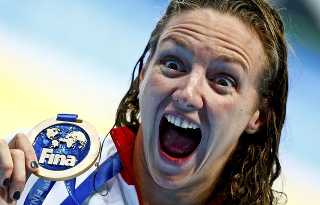 Katinka Hosszu of Hungary displays her gold medal after winning the women's 200m individual medley final at the Aquatics World Championships in Kazan, Russia August 3, 2015. (Photo by Hannibal Hanschke/Reuters)