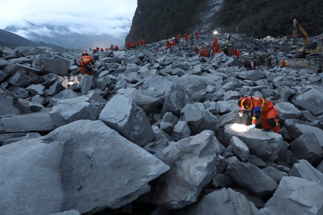 Rescue workers search for survivors at the site of a landslide that occurred in Xinmo Village, Mao County, Sichuan province, China June 24, 2017. (Photo by Reuters/Stringer)