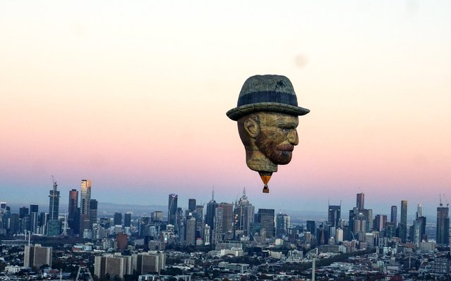 An incredible 27m tall hot air balloon, shaped like Dutch post-impressionist painter Vincent Van Gogh's head, sores over the morning Melbourne skyline to promote the 2019 King Valley Balloon Festival starting this June, on May 23 2019. The reproduction of one of the artist's most famous works, Self-Portrait with Grey Felt Hat, has been turned into a 27m tall balloon. Printed from a high resolution image of the 1887 self-portrait, the balloon by Dutch company Bavaria BV reportedly cost around £220,350 to make. (Photo by Goldrush Ballooning/South West News Service)