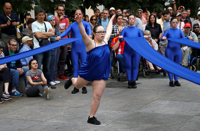 A dance group of people with disabilities performs in front of Spain's parliament during a protest by groups of people with disabilities against voting restrictions in Madrid, Spain June 17, 2016. (Photo by Andrea Comas/Reuters)