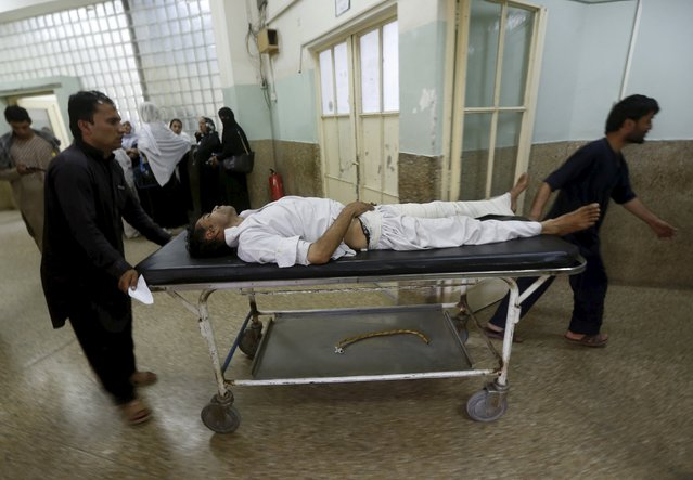 An Afghan man receives treatment at a hospital after a suicide car bomb in Kabul, Afghanistan August 10, 2015. (Photo by Omar Sobhani/Reuters)