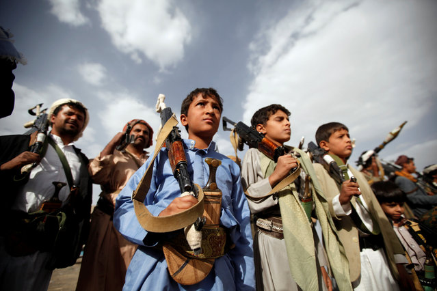 Boys hold rifles as they attend a pro-Houthi tribal gathering in Sanaa, Yemen June 20, 2016. (Photo by Khaled Abdullah/Reuters)