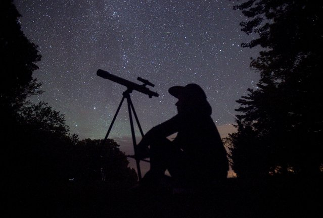 A stargazer waits for the Perseid meteor shower to begin near Bobcaygeon, Ontario, August 12, 2015. (Photo by Fred Thornhill/Reuters)