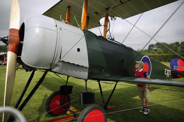 "Aviation enthusiast Patrick Wilson 8, from Wetherby looks at  an Avro 504 k at ""The Shuttlesworth Collection"" at Old Warden on July 21, 2014 in Biggleswade, England. Of the 55,000 planes that were manufactured by the Royal Army Corps (RAC) during WWI, only around 20 remain in airworthy condition. (Photo by Dan Kitwood/Getty Images)"