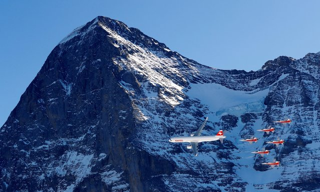 A Swiss Airbuss A321 and Patrouille Suisse during a display at the FIS Ski World Cup in Wengen, Switzerland on January 16, 2020. (Photo by Leonhard Foeger/Reuters)