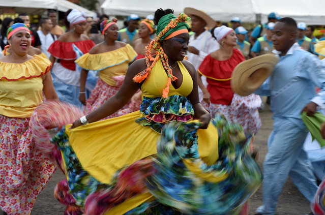 Members of a dance group perform during the 21st edition of the Pacific Music Festival Petronio Alvarez in Cali, Colombia, 17 August 2017. The annual festival presents five days of folk music from the Colombian Pacific coast. (Photo by Ernesto Guzman Jr./EPA)