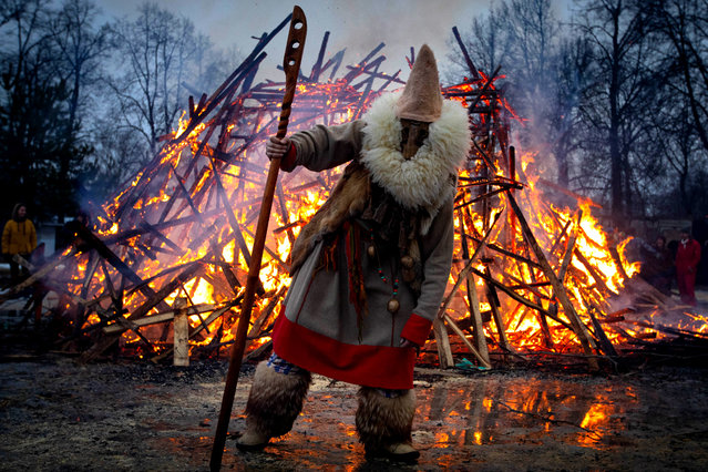 Burning an effigy of winter during a celebration of Maslenitsa festival (Pancake Week) at the Guslitsa Art Estate in Moscow Region, Russia on March 1, 2020. The holiday celebrates the end of winter and marks the arrival of spring. (Photo by Stanislav Krasilnikov/TASS)