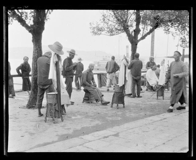 Barbers on Bund. China, Yichang Shi, 1917-1919. (Photo by Sidney David Gamble)