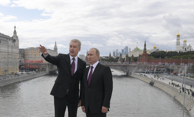 Russian President Vladimir Putin, right, and Moscow Mayor Sergei Sobyanin visit the Zaryadye Park in Moscow, Russia, Saturday, September 9, 2017. With a visit from President Putin, Moscow has inaugurated an innovative 32-acre (13-hectare) Zaryadye Park that mimics features of Russia's landscape on land where a notoriously unsightly hotel once sprawled, coming as part of observances commemorating Moscow's 870th anniversary. (Photo by Alexei Druzhinin, Sputnik, Kremlin Pool Photo via AP Photo)