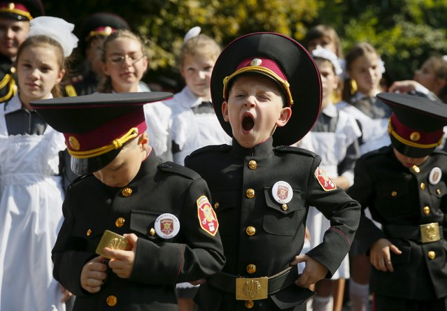 First graders of a cadet's lyceum attend a ceremony to mark the start of the new school year in Kiev, Ukraine, September 1, 2015. (Photo by Valentyn Ogirenko/Reuters)