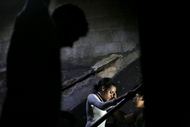 Massiel Borgesm, 18 (C), gets ready backstage to perform during the Cuban Otaku festival in Havana, Cuba, July 24, 2016. (Photo by Alexandre Meneghini/Reuters)