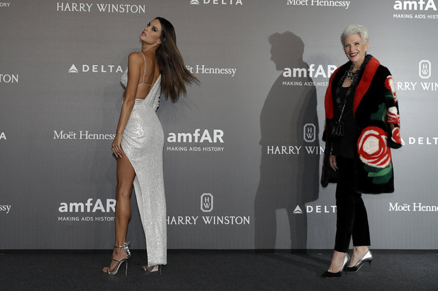 Model Alessandra Ambrosio, left, poses with Maye Musk as they arrive for the amfAR charity dinner during the fashion week in Milan, Italy, Thursday, September 21, 2017. (Photo by Antonio Calanni/AP Photo)