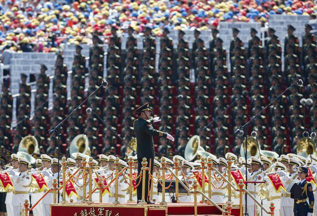 A conductor leads People's Liberation Army bands during the military parade marking the 70th anniversary of the end of World War Two, in Beijing, China, September 3, 2015. (Photo by Rolex Dela Pena/Reuters)