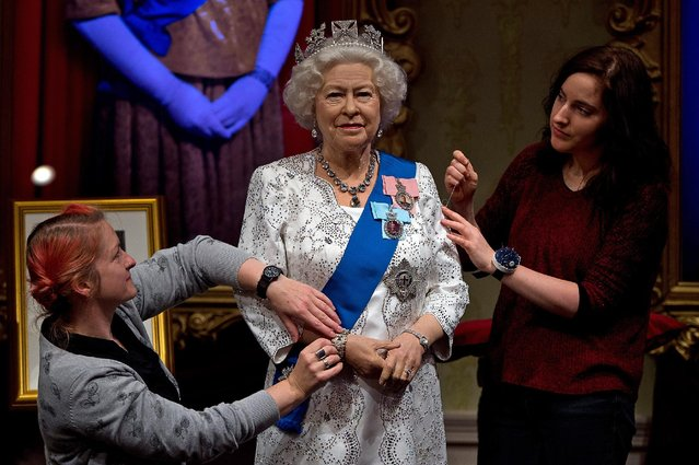Madame Tussauds refreshes its Queen Elizabeth II wax figure with a recreation of the longest reigning monarch's diamond jubilee dress at Madame Tussauds on September 7, 2015 in London, England. The wax figure was updated after Buckingham Palace announced that on September 9, 2015 Queen Elizabeth II would surpass Queen Victoria as the longest reigning monarch. (Photo by Ben Pruchnie/Getty Images)