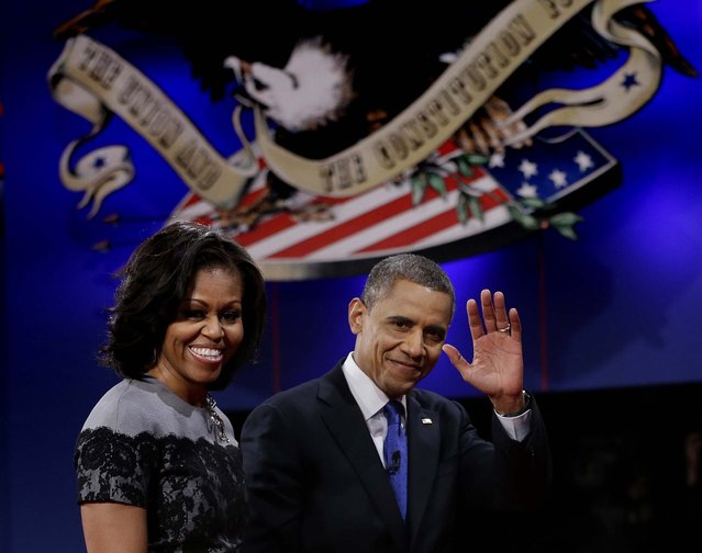 President Barack Obama and his wife Michelle walks off stage following the third presidential debate with Republican presidential nominee Mitt Romney at Lynn University, Monday, October 22, 2012, in Boca Raton, Fla. (Photo by Eric Gay/AP Photo)