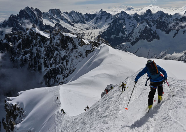 "Mountaineers ski to the ""Vallee Blanche"" a glacial valley located in the Mont-Blanc massif, from the ""Aiguille du Midi"" peak in Chamonix, on May 16, 2020, on the first day of the reopening as France eases lockdown measures taken to curb the spread of the COVID-19 pandemic, caused by the novel coronavirus. (Photo by Philippe Desmazes/AFP Photo)"