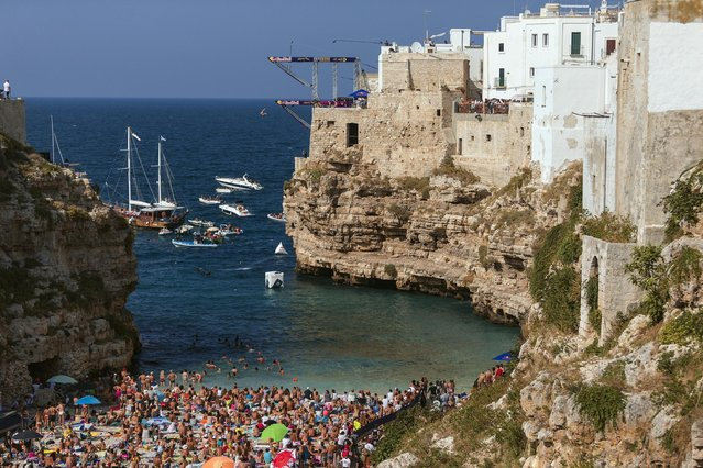 Rachelle Simpson of the USA dives from the 21 metre platform during the first competition day of the fifth stop of the Red Bull Cliff Diving World Series in Polignano a Mare, Italy on August 27, 2016. (Photo by Dean Treml/ANSA/Red Bull Press Office)