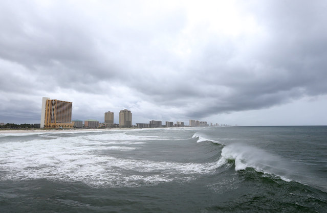 Waves break in the water as rain moves in near the County Pier, Thursday, September 1, 2016, in Panama City Beach, Fla. Tropical Storm Hermine strengthened into a hurricane Thursday and steamed toward Florida's Gulf Coast, where people put up shutters, nailed plywood across store windows and braced for the first hurricane to hit the state in over a decade. (Photo by Patti Blake/News Herald via AP Photo)