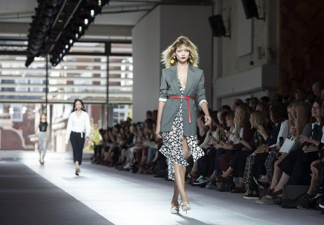 A model wears an outfit by Topshop Unique, during their Spring/Summer 2016 show for London Fashion Week, central London, Sunday, September 20, 2015. (Photo by Lauren Hurley/PA Wire via AP Photo)