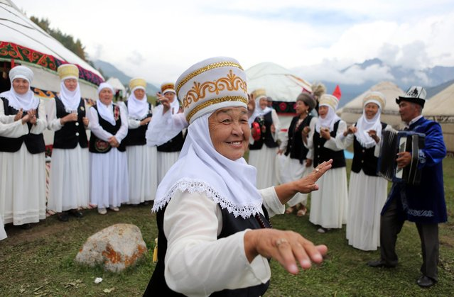 A Kyrgyz woman dances during the 2nd World Nomad Games at Issyk-Kul lake in Cholpon-Ata, Kyrgyzstan, 04 September 2016. Teams from Azerbaijan, Kazakhstan, Mongolia, Kazakhstan and Tajikistan are competing in ethnic sport games during the cultural event that runs from 03 to 08 September. The mission of the games is to promote the revival and preservation of the historical heritage of the nomadic peoples of the world civilization. (Photo by Igor Kovalenko/EPA)