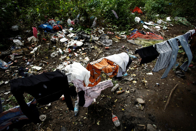 Clothes of African migrants stranded in Costa Rica dry near trash at a makeshift camp at the border between Costa Rica and Nicaragua, in Penas Blancas, Costa Rica, September 8, 2016. (Photo by Juan Carlos Ulate/Reuters)